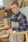 Portrait young carpentry apprentice. Portrait of young carpentry apprentice Royalty Free Stock Image
