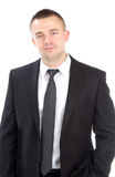 Portrait of a young casual business man. Standing against white background Royalty Free Stock Photography