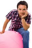 Portrait of young casual man seated Stock Photos