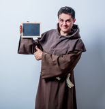 Portrait of Young catholic monk with board. On white background Royalty Free Stock Image