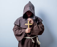Portrait of Young catholic monk with cross. On white background Stock Photography