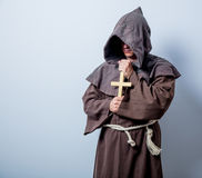 Portrait of Young catholic monk with cross Stock Photo