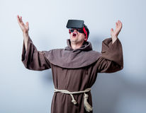 Portrait of Young catholic monk with 3D glasses Stock Photos
