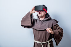 Portrait of Young catholic monk with 3D glasses Royalty Free Stock Images