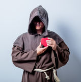 Portrait of Young catholic monk with heart shape Stock Image