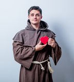 Portrait of Young catholic monk with heart shape Royalty Free Stock Photo