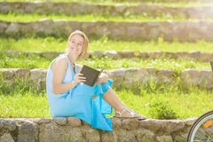 Portrait of  Young Caucasian Blond Woman Reading Digital eBook Stock Photos