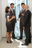 Portrait of young caucasian business people talking in office Stock Photos