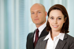 Portrait of young caucasian businessman and businesswoman in off Royalty Free Stock Photo