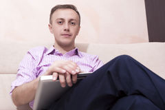 Portrait of Young Caucasian Businessman With Laptop Sitting On C Royalty Free Stock Photography