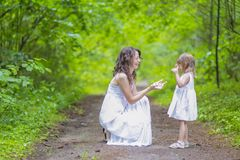 Portrait of Young Caucasian Family Couple Posing Together In Green Summer Forest.Positive Facial Expression. royalty free stock photography