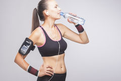 Portrait of Young Caucasian Fit Woman Drinking Water Stock Photos