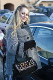 Portrait of Young Caucasian Girl in Light Coat Posing with Purse stock photography