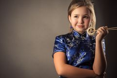 Portrait young caucasian girl with roll in hands royalty free stock photography