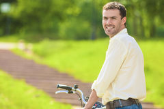 Portrait of Young Caucasian Handsome Walking with Bicycle Stock Photos
