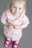 Portrait of Young Caucasian Little Girl Trying On Mother's Shoes Royalty Free Stock Photography