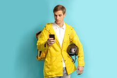 Young caucasian delivery man in yellow unifrom
