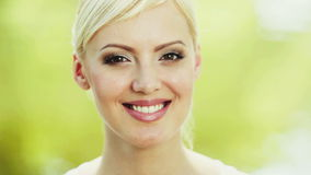 Portrait of young caucasian smiling woman looking stock video