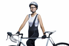 Portrait of young caucasian sportswoman p standing with bicycle Royalty Free Stock Photos