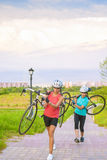 Portrait of Young Caucasian Sportswomen Work Out with Bicycle Ou Stock Photos