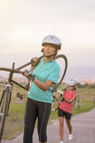 Portrait of Young Caucasian Sportswomen Work Out with Bicycle Ou Royalty Free Stock Photo