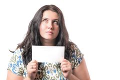 Portrait of young caucasian woman brunette holding blank badge sign in her hands isolated on white background. Free space for your royalty free stock photos