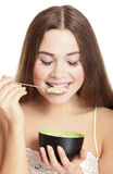 Portrait of young caucasian woman eating cereals Stock Photos