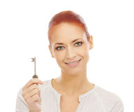 Portrait of a young Caucasian woman holding a key Stock Photo