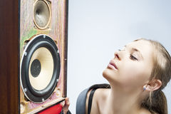 Portrait of Young Caucasian Woman Listening to Speaker Stock Photo