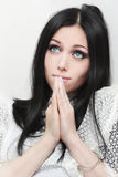 Portrait of a young caucasian woman praying Royalty Free Stock Photography