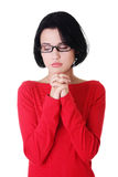 Portrait of a young caucasian woman praying. Closeup portrait of a young caucasian woman praying Stock Photos