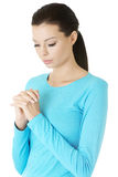 Portrait of a young caucasian woman praying. Closeup portrait of a young caucasian woman praying Royalty Free Stock Image
