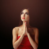 Portrait of a young caucasian woman praying Royalty Free Stock Photos