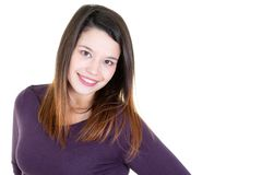 Portrait of young caucasian woman in purple shirt casually standing near white wall. A Portrait of young caucasian woman in purple shirt casually standing near stock image