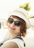 Portrait of young caucasian woman with sun hat and sunglasses Stock Image