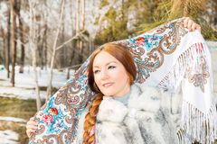 Portrait of young caucasian woman in traditional russian pavloposadskie  folk scarf on head. Stock Photo