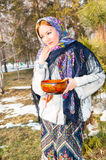 Portrait of young caucasian woman in traditional russian pavloposadskie  folk scarf on head. Royalty Free Stock Photos