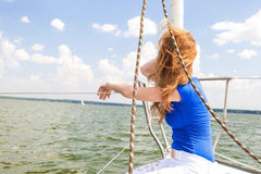 Portrait of Young Caucasian Woman Travelling Under Sail on Water Royalty Free Stock Photo