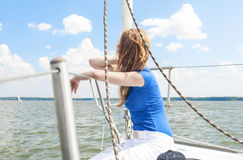 Portrait of Young Caucasian Woman Travelling Under Sail on Water Royalty Free Stock Image