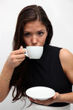 Portrait of young charming girl. With a cup of coffee on a white background Stock Photo