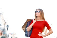 Portrait young charming long-haired woman holding shopping bags Stock Photo