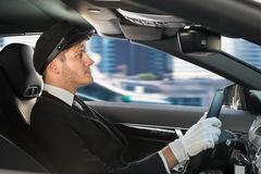 Portrait Of Young Chauffeur In Car Royalty Free Stock Photo