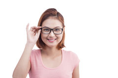 Portrait of a young cheerful asian woman in glasses Stock Image
