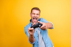 Portrait of young, cheerful, attractive, very excited guy holdin royalty free stock images