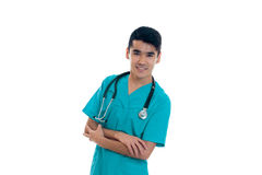 Portrait of young cheerful brunette man doctor in blue uniform with stethoscope smiling on camera crossed hands isolated Stock Photo