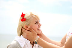 Portrait of a young cheerful girl. Pretty blond teen girl smiling closeup royalty free stock photos