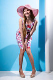 Portrait of a young cheerful girl with a hat full length smiling Stock Photography