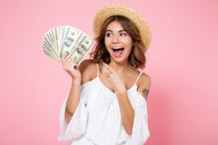 Portrait of a young cheerful girl with open mouth, pointing fing Stock Photo