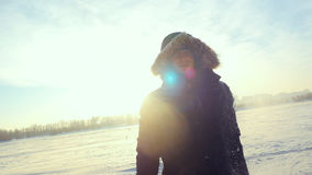 Portrait of young cheerful man outdoors in winter sunny day at sunset time with beautiful lense flare effects Stock Image