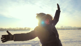 Portrait of young cheerful man outdoors in winter sunny day at sunset time with beautiful lense flare effects Stock Photo